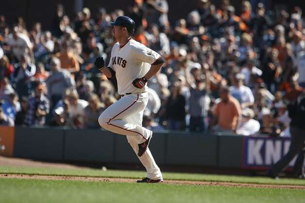 The Giants' Aubrey Huff  rounds the bases after hitting a double in the sixth inning.  The San Francisco Giants played the Colorado Rockies at AT&T Park  on Thursday,  September 20, 2012 in San Francisco, Calif. Final Score: San Francisco Giants: 9 - Colorado Rockies: 2 Photo: Lea Suzuki, The Chronicle