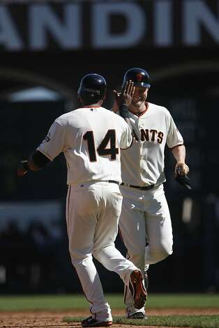 The Giants' Aubrey Huff (right) high fives Francisco Peguero (left) who ran for him after Huff  hit a double in the sixth inning.  The San Francisco Giants played the Colorado Rockies at AT&T Park  on Thursday,  September 20, 2012 in San Francisco, Calif. Final Score: San Francisco Giants: 9 - Colorado Rockies: 2 Photo: Lea Suzuki, The Chronicle