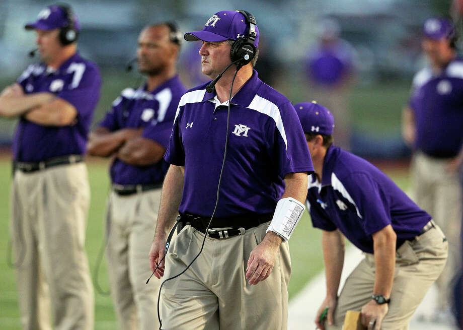 Todd Dodge watches his Mustangs as Champion hosts Marble Falls at Boerne Stadium on September 20, 2012. Photo: Tom Reel, Express-News / ©2012 San Antono Express-News