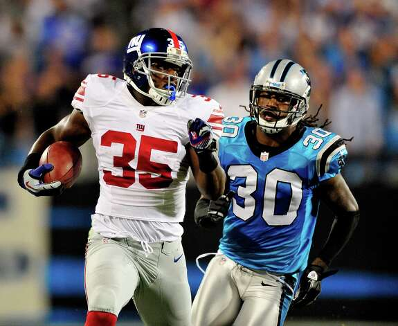 CHARLOTTE, NC - SEPTEMBER 20:  Andre Brown #35 of the New York Giants breaks away from Charles Godfrey #30 of the Carolina Panthers for a long gain during play at Bank of America Stadium on September 20, 2012 in Charlotte, North Carolina.  (Photo by Grant Halverson/Getty Images) Photo: Grant Halverson