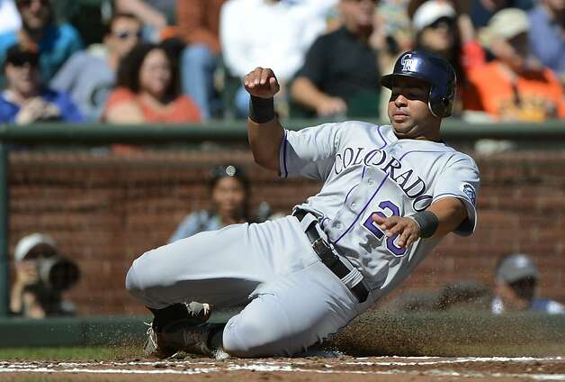 SAN FRANCISCO, CA - SEPTEMBER 20: Wilin Rosario #20 of the Colorado Rockies scores on an RBI single from Jonathan Herrera #18 (not pictured) in the second inning against the San Francisco Giants at AT&T Park on September 20, 2012 in San Francisco, California. (Photo by Thearon W. Henderson/Getty Images) Photo: Thearon W. Henderson, Getty Images