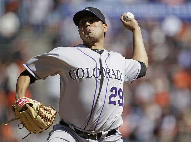 Colorado Rockies starting pitcher Jorge De La Rosa throws to a San Francisco Giants batter during the first inning of a baseball game in San Francisco, Thursday, Sept. 20, 2012. (AP Photo/Eric Risberg) Photo: Eric Risberg, Associated Press