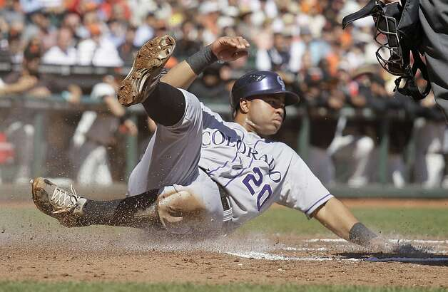 Colorado Rockies' Wilin Rosario slides safely into home plate to score the Rockies first run during the second inning of a baseball game against the San Francisco Giants in San Francisco, Thursday, Sept. 20, 2012. (AP Photo/Eric Risberg) Photo: Eric Risberg, Associated Press
