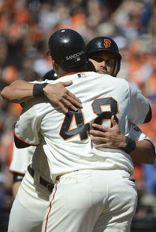 SAN FRANCISCO, CA - SEPTEMBER 20:  Pablo Sandoval #48 and Angel Pagan #16 of the San Francisco Giants hugs each other at home plate after Sandoval hit a three-run home run in the fourth inning against the Colorado Rockies at AT&T Park on September 20, 2012 in San Francisco, California. The home run was Sandovals second of the day.  (Photo by Thearon W. Henderson/Getty Images) Photo: Thearon W. Henderson, Getty Images