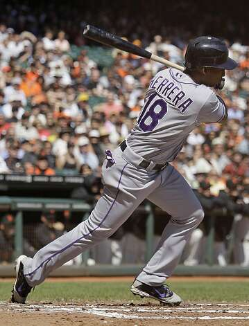 Colorado Rockies' Jonathan Herrera follows through on an RBI single off San Francisco Giants starting pitcher Barry Zito during the second inning of a baseball game in San Francisco, Thursday, Sept. 20, 2012. (AP Photo/Eric Risberg) Photo: Eric Risberg, Associated Press
