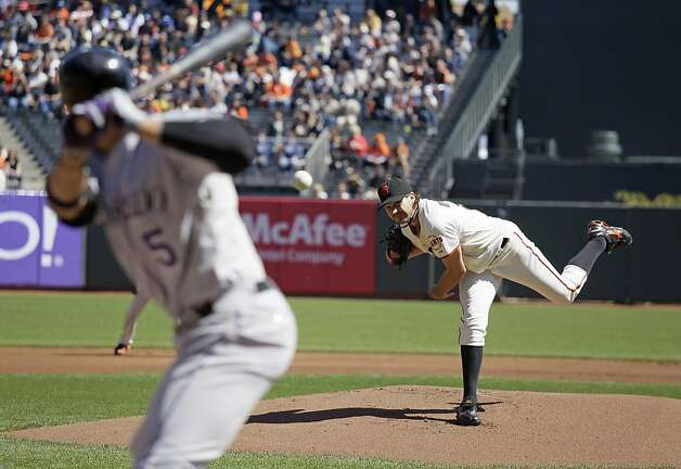 San Francisco Giants starting pitcher Barry Zito, right, throws against Colorado Rockies' Carlos Gonzalez, left, during the first inning of a baseball game in San Francisco, Thursday, Sept. 20, 2012. (AP Photo/Eric Risberg) Photo: Eric Risberg, Associated Press
