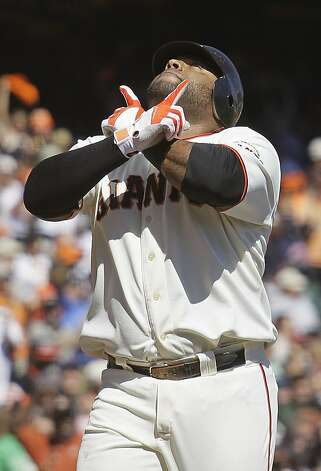 San Francisco Giants' Pablo Sandoval gestures while crossing home plate after hitting a home run off Colorado Rockies starting pitcher Jorge De La Rosa in the first inning of a baseball game in San Francisco, Thursday, Sept. 20, 2012. (AP Photo/Eric Risberg) Photo: Eric Risberg, Associated Press