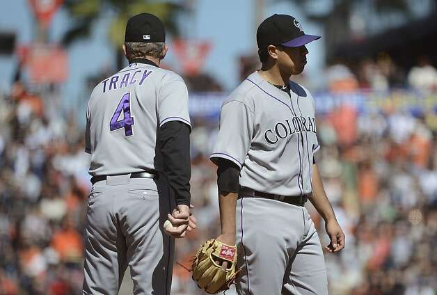 SAN FRANCISCO, CA - SEPTEMBER 20: Manager Jim Tracy #4 of the Colorado Rockies takes the ball from pitcher Jorge De La Rosa #29 taking him out of the game in the fourth inning against the San Francisco Giants at AT&T Park on September 20, 2012 in San Francisco, California.  (Photo by Thearon W. Henderson/Getty Images) Photo: Thearon W. Henderson, Getty Images