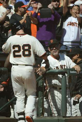 SAN FRANCISCO, CA - SEPTEMBER 20:  Buster Posey #28 of the San Francisco Giants is congratulated by manager Bruce Bochy (R) after Posey hit a solo home run in the fourth inning against the Colorado Rockies at AT&T Park on September 20, 2012 in San Francisco, California.  (Photo by Thearon W. Henderson/Getty Images) Photo: Thearon W. Henderson, Getty Images