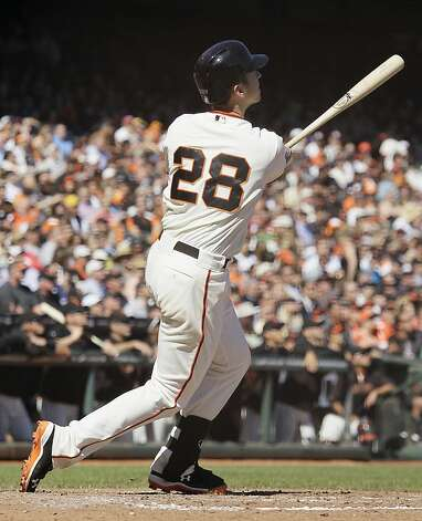 San Francisco Giants' Buster Posey hits a home run off Colorado Rockies relief pitcher Edgmer Escalona during the fourth inning of their baseball game in San Francisco, Thursday, Sept. 20, 2012. (AP Photo/Eric Risberg) Photo: Eric Risberg, Associated Press