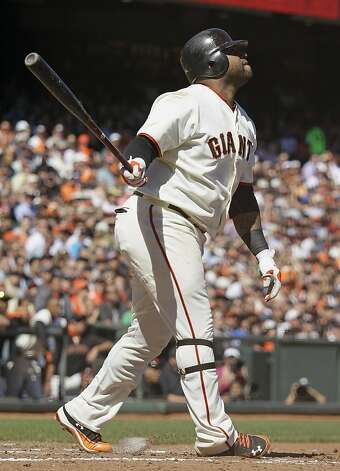 San Francisco Giants' Pablo Sandoval hits a three-run homer off Colorado Rockies relief pitcher Edgmer Escalona during the fourth inning of their baseball game in San Francisco, Thursday, Sept. 20, 2012. (AP Photo/Eric Risberg) Photo: Eric Risberg, Associated Press