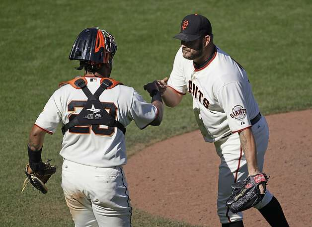 San Francisco Giants relief pitcher Brad Penny, right, is greeted by catcher Hector Sanchez, left, at the end of a baseball game against the Colorado Rockies in San Francisco, Thursday, Sept. 20, 2012. San Francisco won 9-2. (AP Photo/Eric Risberg) Photo: Eric Risberg, Associated Press