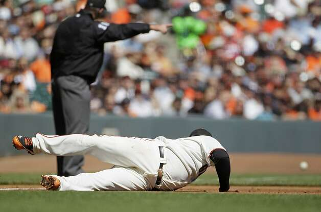 San Francisco Giants third baseman Pablo Sandoval dives and misses a double hit by Colorado Rockies' Josh Rutledge during the third inning of a baseball game in San Francisco, Thursday, Sept. 20, 2012. (AP Photo/Eric Risberg) Photo: Eric Risberg, Associated Press