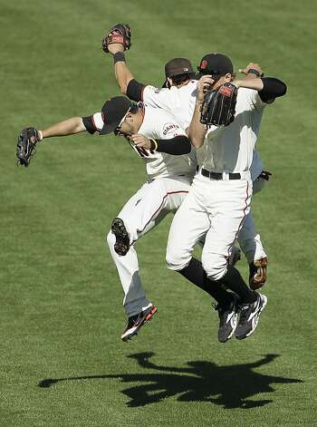 San Francisco Giants outfielders from left, Gregor Blanco, Angel Pagan and Hunter Pence celebrate at the end of their baseball game against the Colorado Rockies in San Francisco, Thursday, Sept. 20, 2012. San Francisco won the game 9-2. (AP Photo/Eric Risberg) Photo: Eric Risberg, Associated Press
