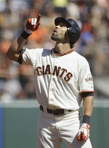 San Francisco Giants' Angel Pagan after hitting a double in the third inning of a baseball game against the Colorado Rockies in San Francisco, Thursday, Sept. 20, 2012. (AP Photo/Eric Risberg) Photo: Eric Risberg, Associated Press