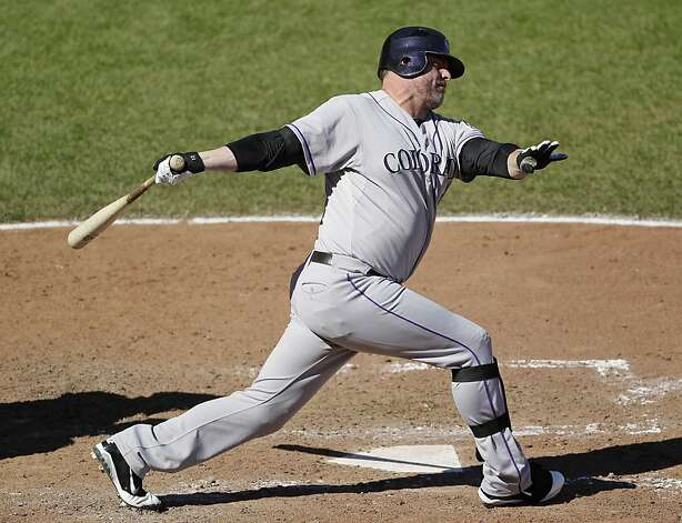 Colorado Rockies' Jason Giambi swings and misses at a pitch thrown by San Francisco Giants reliever Guillermo Mota in the seventh inning of a baseball game in San Francisco, Thursday, Sept. 20, 2012. San Francisco won the game 9-2. (AP Photo/Eric Risberg) Photo: Eric Risberg, Associated Press