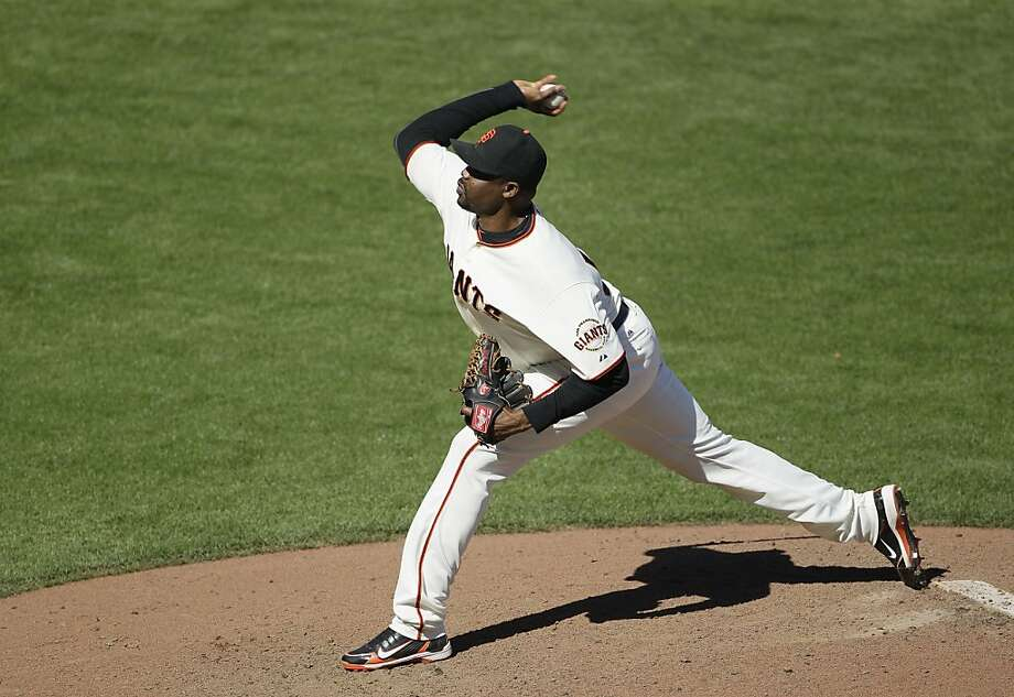 San Francisco Giants relief pitcher Guillermo Mota throws against the Colorado Rockies during a baseball game in San Francisco, Thursday, Sept. 20, 2012. (AP Photo/Eric Risberg) Photo: Eric Risberg, Associated Press