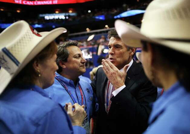 TAMPA, FL - AUGUST 29:  Rosemary Edwards of Austin, Texas and Steve Monisteri talk with Texas Gov. Rick Perry during the third day of the Republican National Convention at the Tampa Bay Times Forum on August 29, 2012 in Tampa, Florida. Former Massachusetts Gov. Mitt Romney was nominated as the Republican presidential candidate during the RNC, which is scheduled to conclude August 30. (Chip Somodevilla / Getty Images) Photo: Chip Somodevilla, Getty Images / 2012 Getty Images