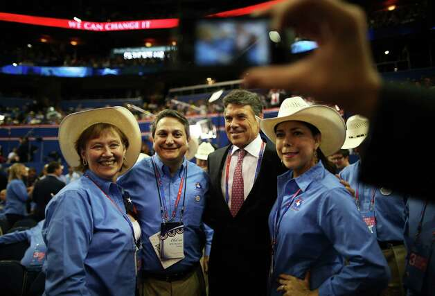 TAMPA, FL - AUGUST 29:  Rosemary Edwards (L) of Austin, Texas and Steve Monisteri pose for a photo with Texas Gov. Rick Perry (2R) during the third day of the Republican National Convention at the Tampa Bay Times Forum on August 29, 2012 in Tampa, Florida. Former Massachusetts Gov. Mitt Romney was nominated as the Republican presidential candidate during the RNC, which is scheduled to conclude August 30.  (Chip Somodevilla / Getty Images) Photo: Chip Somodevilla, Getty Images / 2012 Getty Images