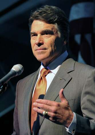 "Former Republican party presidential candidate Governor Rick Perry speaks during a pro-life event called ""Treasure Life"" at the Tampa Aquarium in Tampa, Florida on August 28, 2012. The Republican National Coalition for Life and FRC Action's event, ""Treasure Life,"" honored the pro-life contributions of the former Republican party presidential candidates Sen. Rick Santorum, Rep. Michele Bachmann and Gov. Rick Perry for their advocacy for every stage of life, from conception to natural death.  (MLADEN ANTONOV / AFP/Getty Images) Photo: MLADEN ANTONOV, AFP/Getty Images / AFP"