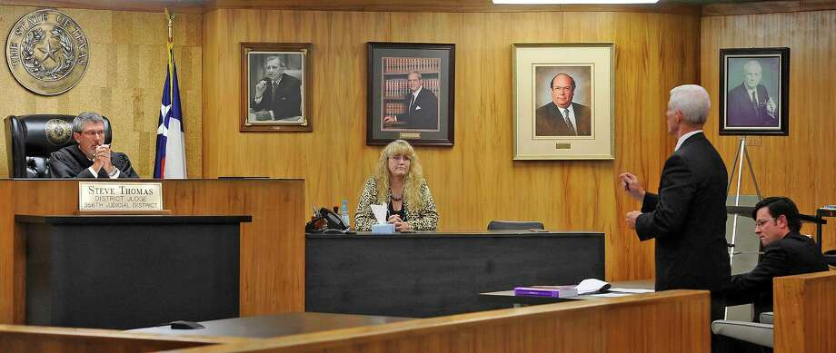 Attorneys David Starnes, second from right, and J. Michael Johnson, right, present their case to District Judge Steve Thomas, left, of the 356 District Court. Hardin County District Clerk Pam Hartt, middle, watches the proceedings.  A temporary restraining order was filed against the Kountze school district at the Hardin County courthouse Thursday afternoon and a hearing with District Judge Steve Thomas happened right afterwards. Parents are suing on behalf of the cheerleaders after the district banned the cheerleaders from using signs and banners with scripture verses on them at football games.   Dave Ryan/The Enterprise