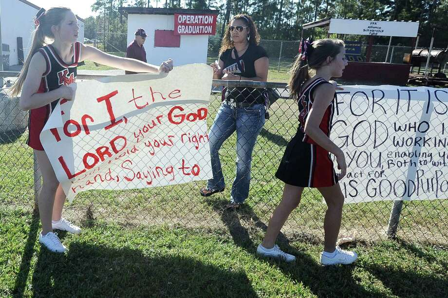 After a judge granted a temporary restraining order in the Kountze cheerleader case, the cheerleaders of Kountze Middle School used their faith-based  signs at the middle school football game held at Kountze High School on Thursday, September 20, 2012. Photo taken: Randy Edwards/The Enterprise