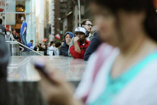 NEW YORK, NY - SEPTEMBER 21:  Customers wait on line to purchase the Apple iPhone 5 outside the Apple Fifth Avenue flagship store on the first morning it went on sale on September 21, 2012 in New York City. Customers lined up for days to purchase the hotly anticipated device which went on sale nationwide today. Photo: Mario Tama, Getty Images / 2012 Getty Images