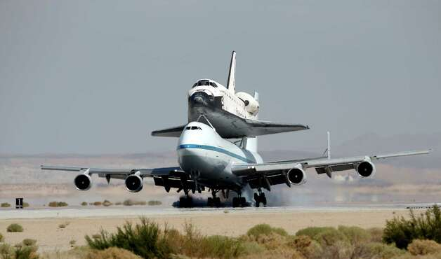 Space Shuttle Endeavour mounted on NASA's Shuttle Carrier Aircraft (SCA) lands at Edwards Air Force Base, Calif., Thursday, Sept. 20, 2012. Photo: Jae C. Hong, AP / AP