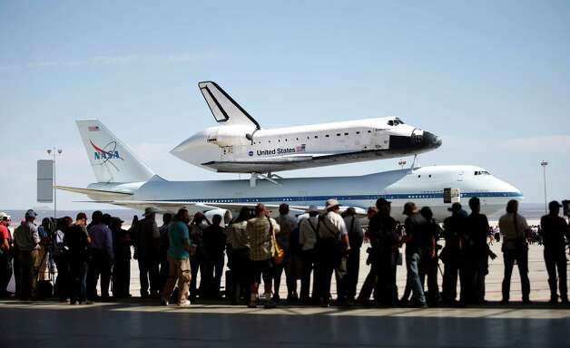 The Space Shuttle Endeavour sits atop NASA's Shuttle Carrier Aircraft (SCA) at the NASA Dryden Flight Research Center at Edwards Air Force Base, Calif., Thursday, Sept. 20, 2012. Endeavour returned to its California roots after a wistful cross-country journey that paid homage to NASA workers and former Arizona Rep. Gabrielle Giffords and her astronaut husband. Photo: Jae C. Hong, AP / AP