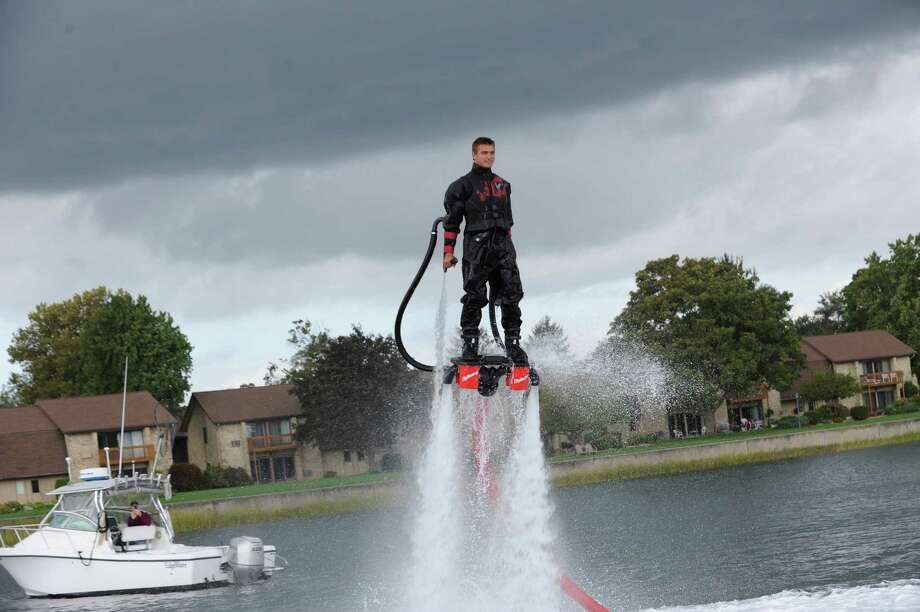 Aaron Gould, of San Diego, CA, flyboarding at the Norwalk Boat Show, Thursday, Sept. 20, 2012. The Norwalk Boat Show, in-water boat show, runs Thursday through Sunday September 20-23, 2012 10am-6pm daily. Photo: Helen Neafsey / Greenwich Time