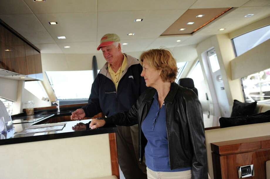 Helgard and Lou Perretta, of Saddle River, N.J., looking at the boats at the Norwalk Show Thursday, Sept. 20, 2012.The Norwalk Boat Show, a in-water boat show, runs Thursday through Sunday September 20-23, 2012 10am-6pm daily. Photo: Helen Neafsey / Greenwich Time