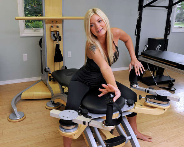 Julie Hurgin, of Bethel, owner of Bodies in Motion in Ridgefield, demonstrates the Gyrotonic arch and curl, Thursday, Sept. 20, 2012. Photo: Carol Kaliff / The News-Times