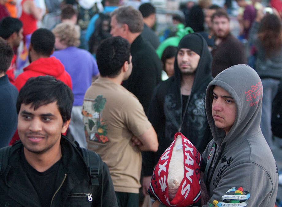 """Customers wait in line for the release of the iPhone 5 outside the Apple Store on Westheimer Friday, Sept. 21, 2012, in Houston. """"I'm interested in the picture piece,"""" she said of the new camera functions. She also said she's looking forward to Siri. Photo: Cody Duty, Houston Chronicle / © 2012 Houston Chronicle"""