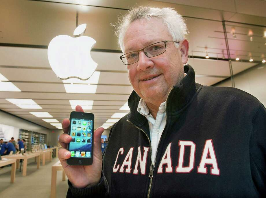 Wayne Anstey displays his new iPhone 5 outside the Apple Store in Halifax, Nova Scotia, Canada  on Friday, Sept. 21, 2012.  (AP Photo/The Canadian Press, Andrew Vaughan) Photo: Andrew Vaughan, Associated Press / The Canadian Press