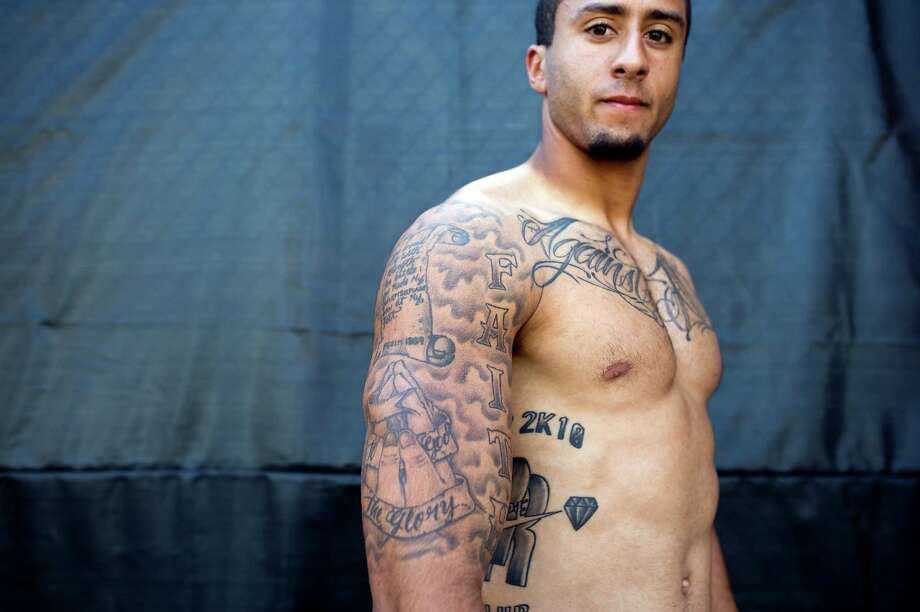 Backup Quarter Back Colin Kaepernick shows off his many tattoo's at the 49ers practice facility in San Carlos, CA Wednesday September 19th, 2012. Photo: Michael Short, Special To The Chronicle / ONLINE_YES