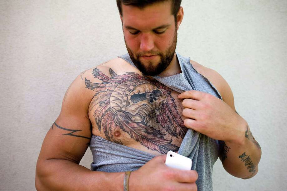 Offensive tackle Alex Boone shows off a large Indian scull with a headdress tattoo while at the 49ers practice facility in San Carlos, CA Wednesday September 19th, 2012. Photo: Michael Short, Special To The Chronicle / ONLINE_YES