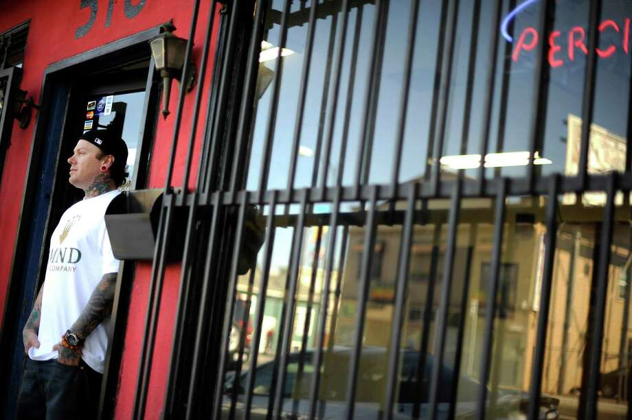 Tattoo Artist Skip Brown is seen at Player's Ink Tattoo Studio in  San Jose, CA Wednesday September 19th, 2012.  Skip has worked on many of the San Francisco 49er players tattoos over the years. Photo: Michael Short, Special To The Chronicle / ONLINE_YES