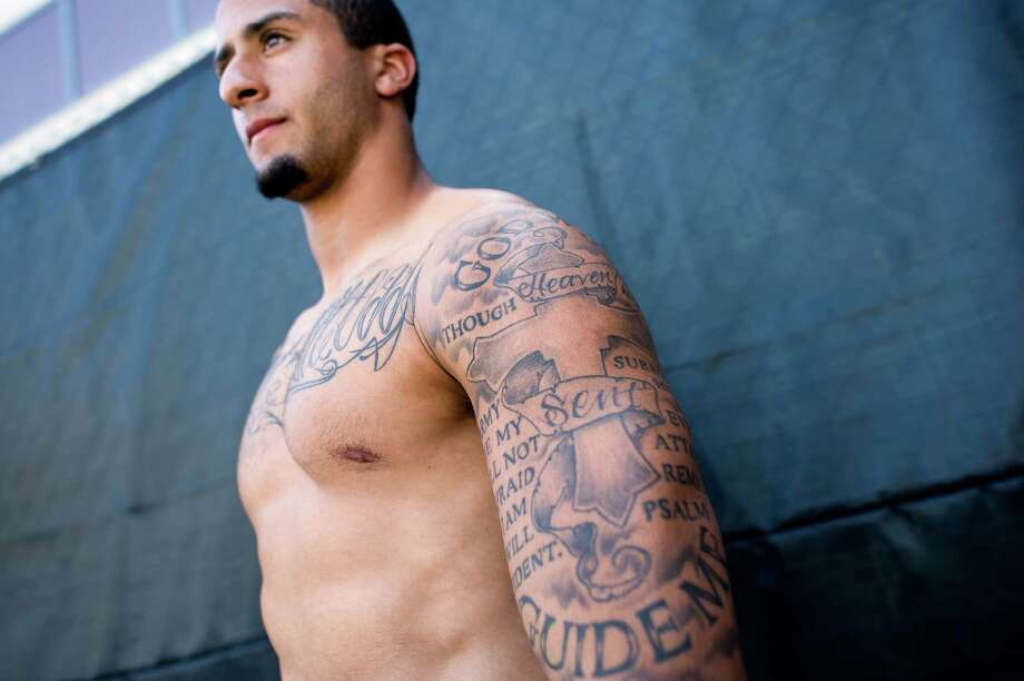Backup quarterback Colin Kaepernick shows off his many tattoos at the 49ers practice facility in San Carlos, CA Wednesday September 19th, 2012. Photo: Michael Short, Special To The Chronicle / ONLINE_YES