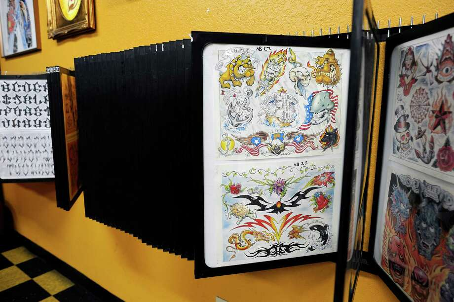 Some of the designs offered at Player's Ink Tattoo Studio. Photo: Michael Short, Special To The Chronicle / ONLINE_YES