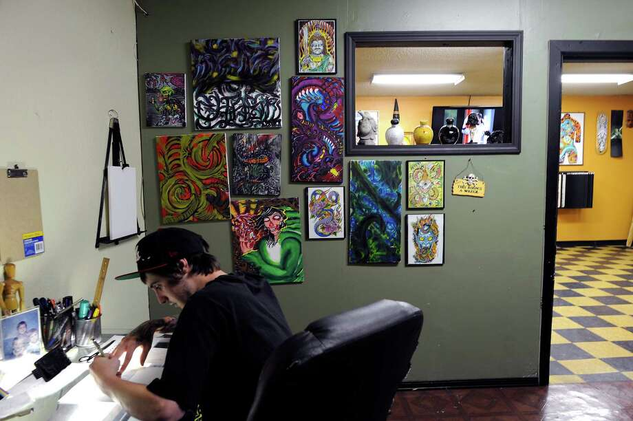Tattoo artist Chase Wilbrecht works on a drawing in his room at Player's Ink Tattoo Studio. Photo: Michael Short, Special To The Chronicle / ONLINE_YES