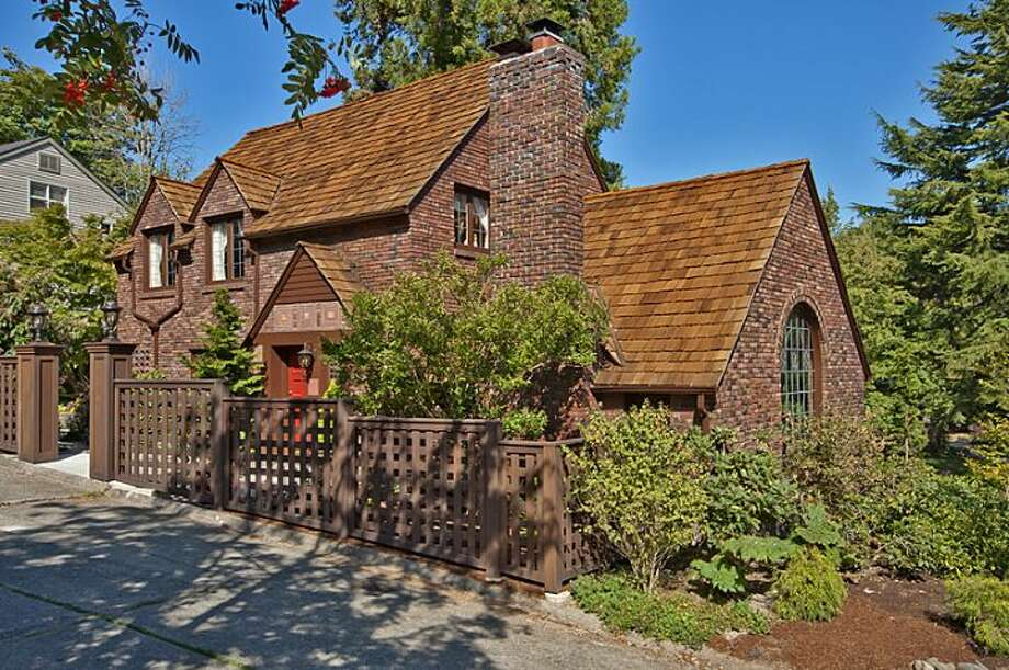 Here's your chance to own a 1930 Denny Blaine brick Tudor designed by renowned Seattle architect Paul Thiry. The house, 335 36th Ave E., is 2,580 square feet, with three bedrooms and 3.25 bathrooms -- including a master suite with a walk-in closet -- a loft, leaded-glass windows, French doors, exposed-wood moldings and beamed ceilings, an updated kitchen, a large patio and a two-car garage on a 5,587-square-foot lot. It's listed for $1.1 million. Photo: Courtesy John Coake And Mark Dickerman/Windermere Real Estate
