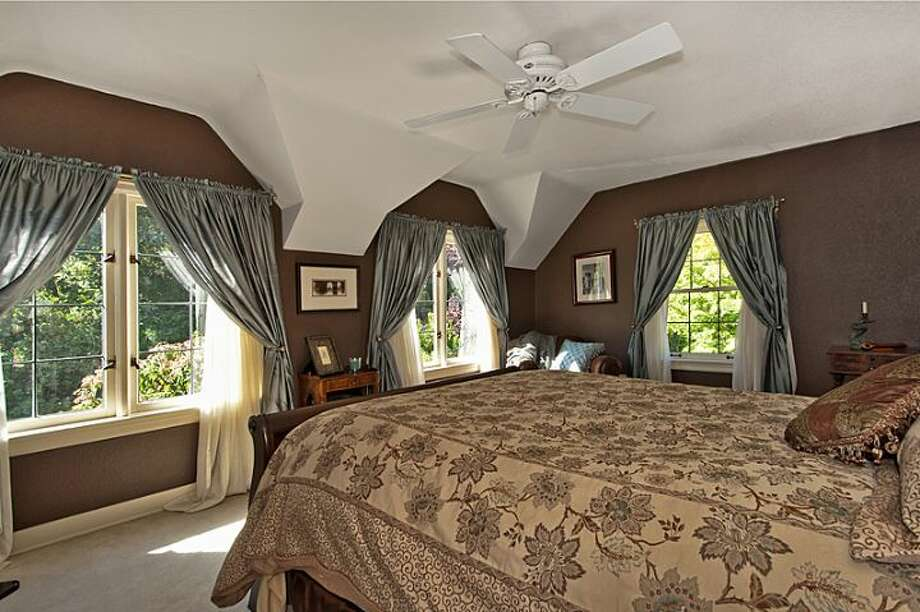 Master bedroom of 335 36th Ave E. The 2,580-square-foot brick Tudor, built in 1930, has with three bedrooms and 3.25 bathrooms, a loft, leaded-glass windows, French doors, exposed-wood moldings and beamed ceilings, an updated kitchen, a large patio and a two-car garage on a 5,587-square-foot lot. It's listed for $1.1 million. Photo: Courtesy John Coake And Mark Dickerman/Windermere Real Estate