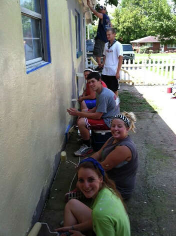 My work crew painting one side of the house.