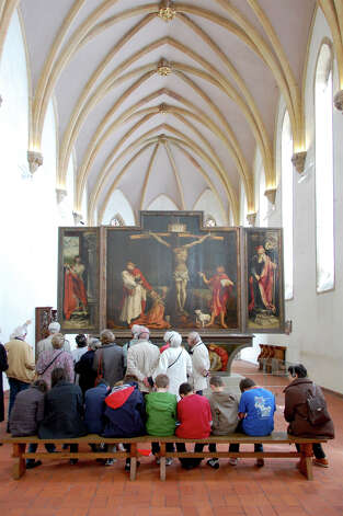 Visitors contemplate Matthias Grunewald's masterpiece, the Isenheim Altarpiece. Photo: Cameron Hewitt, Ricksteves.com