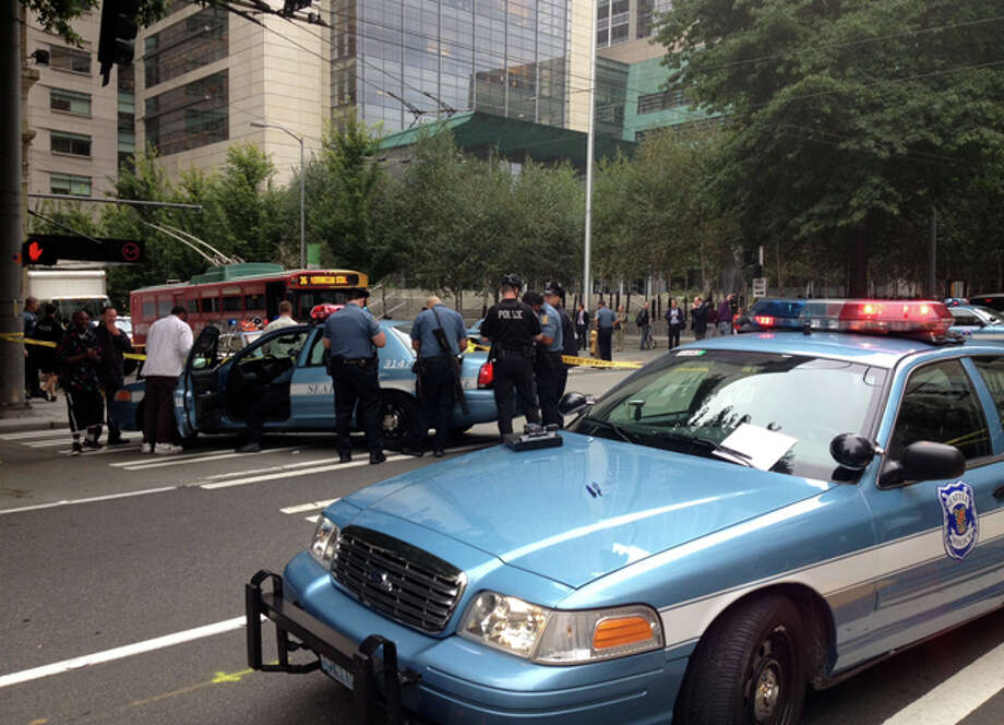 The scene outside Hotel Max at 620 Stewart St. in Seattle where a security guard was shot in the left hand about 10:30 a.m. Sept. 21, 2012. Photo: JoshuaTrujillo/seattlepi.com