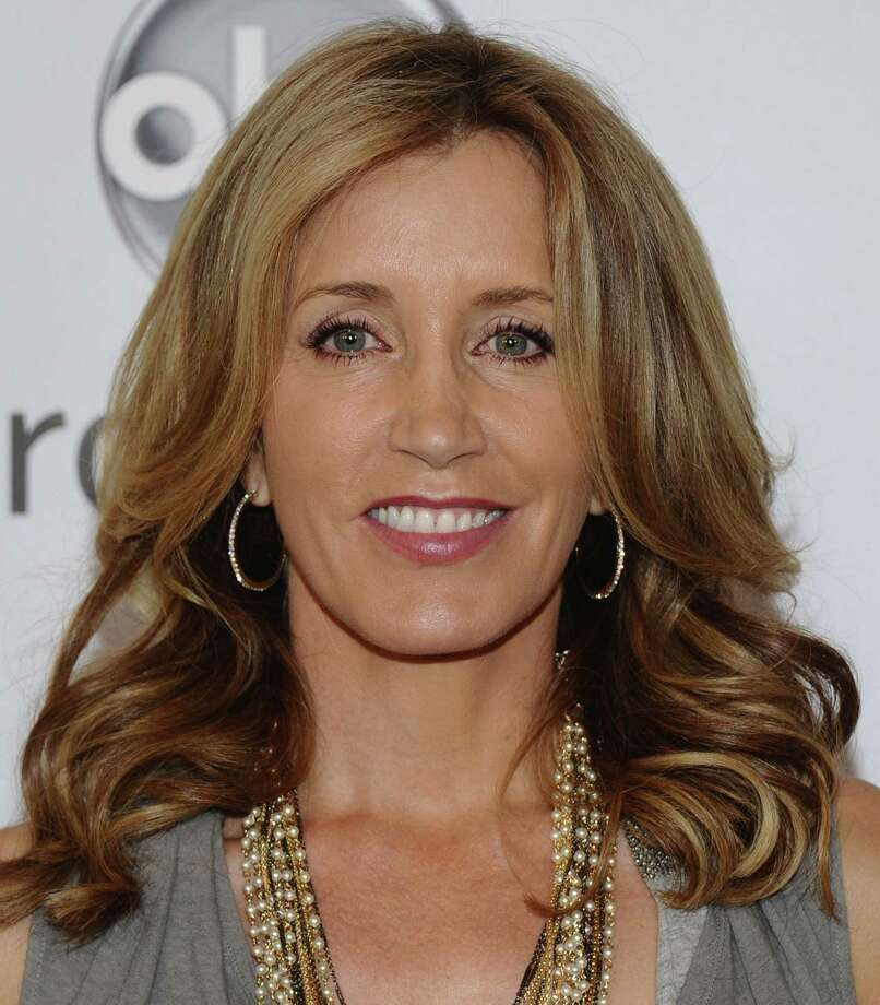 """Felicity Huffman won a Golden Globe and was nominated for an Oscar for her portrayal of a pre-operative transsexual in 2005's """"Transamerica."""" Photo: Michael Buckner, Getty Images / 2011 Getty Images"""