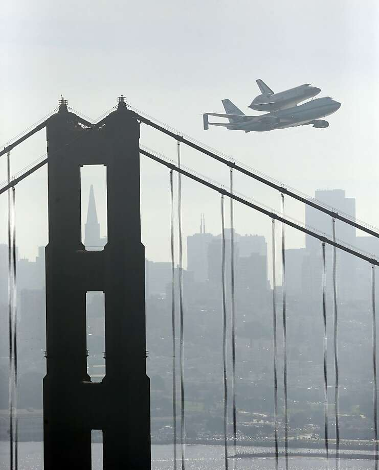Space Shuttle Endeavour mounted on NASA's Shuttle Carrier Aircraft, passes over the Golden Gate Bridge in San Francisco,  Friday, Sept. 21, 2012.  Endeavour is making a final trek across the country to the California Science Center in Los Angeles, where it will be permanently displayed.  (AP Photo/Marcio Jose Sanchez) Photo: Marcio Jose Sanchez, Associated Press