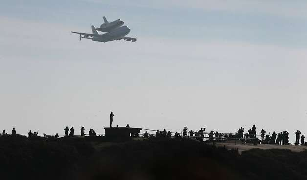 Hundreds of space shuttle enthusiasts gather on the Marin Headlands to watch Endeavour fly above the Golden Gate Bridge on its final bow to the Bay Area before it becomes an exhibit in a Los Angeles museum. Its second flyover was a surprise. Photo: Paul Chinn, The Chronicle