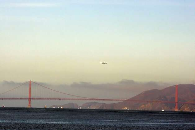 The Space Shuttle Endeavor flew over the Bay Area on Friday, September 21, 2012, in San Francisco, Calif., on its farewell voyage before it is converted to a museum in Los Angeles. Photo: Carlos Gonzalez, The Chronicle