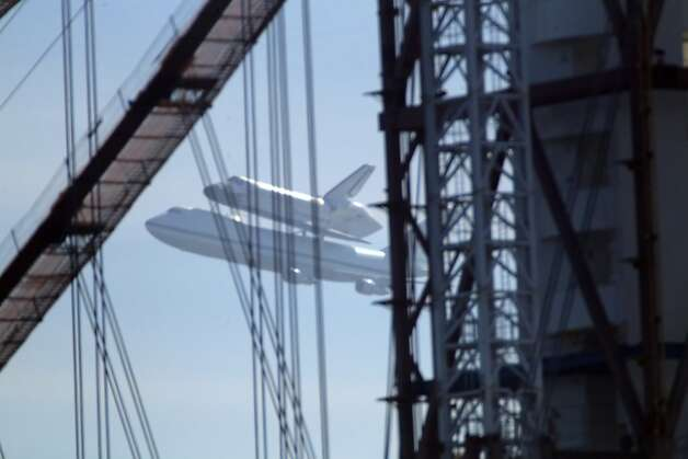 The Space Shuttle Endeavor with the tower of the new section of the Bay Bridge in the foreground as it flew over the Bay Area on Friday, September 21, 2012, in San Francisco, Calif., on its farewell voyage before it is converted to a museum in Los Angeles. Photo: Carlos Avila Gonzalez, The Chronicle